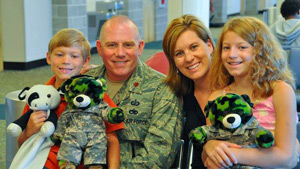 Military Family holding teddy bears