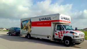 U-Haul Truck driving down a road