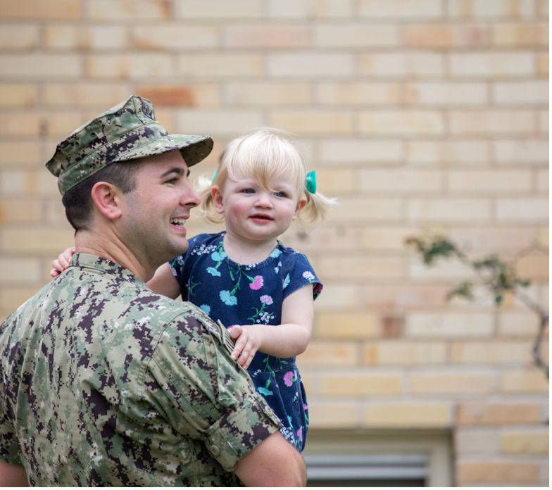 Marine holding his daughter